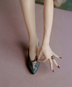 Manicured Hand and Lace-Up Shoes, April 1, 1957